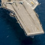 140817-N-CE233 ATLANTIC OCEAN (August 17, 2014) – The Navy's unmanned X-47B conducts flight operations aboard the aircraft carrier USS Theodore Roosevelt (CVN 71). The aircraft completed a series of tests demonstrating its ability to operate safely an