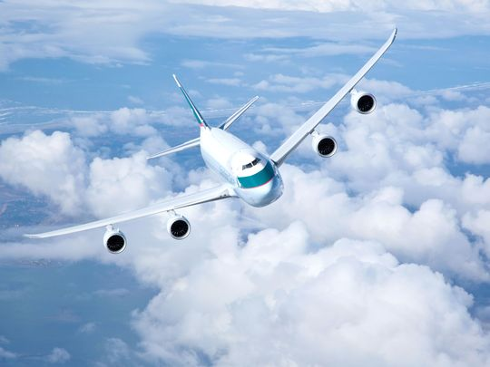 636044350127489278-Cathay-Pacific-747-8-air-to-air-1